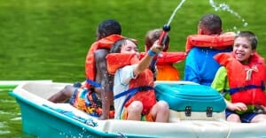 campers having fun on a pedal boat