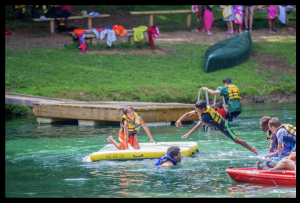 playing in the water at camp
