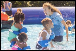 young kids having fun in the pool