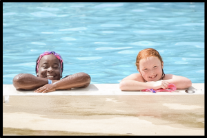 young girls posing in a pool