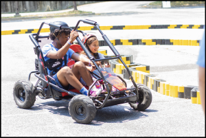 young girl on a go kart