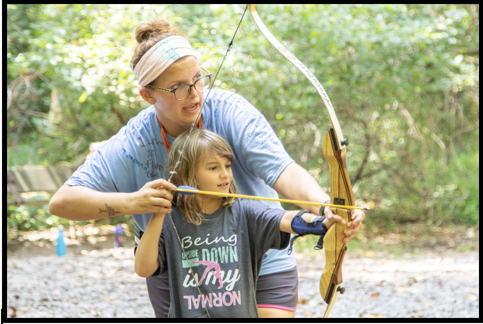 learning archery at camp